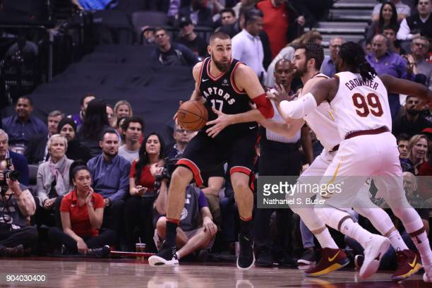Jonas Valanciunas of the Toronto Raptors handles the ball against the Cleveland Cavaliers on January 11 2018 at the Air Canada Centre in Toronto...