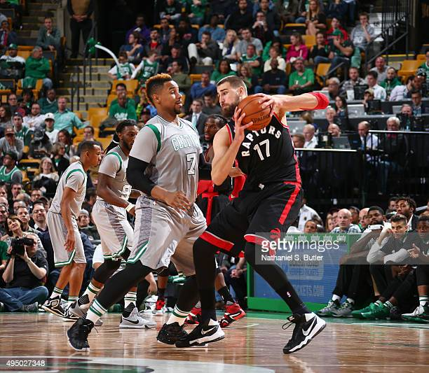 Jonas Valanciunas of the Toronto Raptors is guarded by Jared Sullinger of the Boston Celtics during a game on October 30 2015 at TD Garden in Boston...