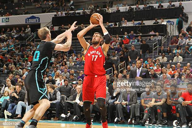 Jonas Valanciunas of the Toronto Raptors passes the ball against the Charlotte Hornets during the game on January 20 2017 at Spectrum Center in...