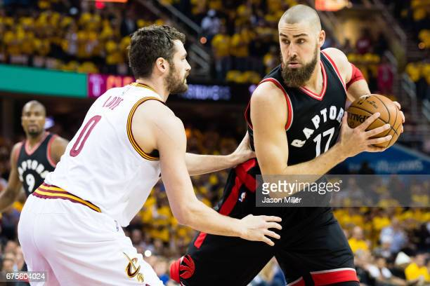 Jonas Valanciunas of the Toronto Raptors posts up against Kevin Love of the Cleveland Cavaliers during the first half of Game One of the NBA Eastern...