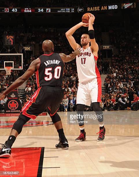 Jonas Valanciunas of the Toronto Raptors shoots against Joel Anthony of the Miami Heat on November 5 2013 at the Air Canada Centre in Toronto Ontario...