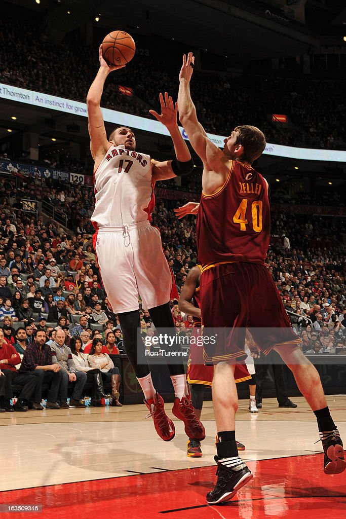 Jonas Valanciunas #17 of the Toronto Raptors shoots against Tyler Zeller #40 of the Cleveland Cavaliers on March 10, 2013 at the Air Canada Centre in Toronto, Ontario, Canada.