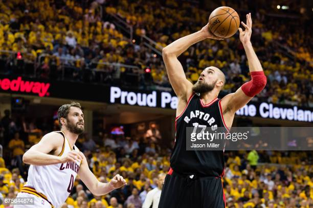 Jonas Valanciunas of the Toronto Raptors shoots over Kevin Love of the Cleveland Cavaliers during the first half of Game One of the NBA Eastern...
