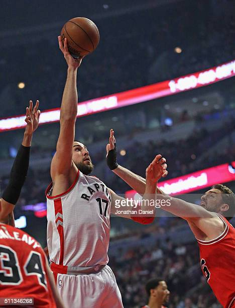Jonas Valanciunas of the Toronto Raptors shoots over Pau Gasol of the Chicago Bulls at the United Center on February 19 2016 in Chicago Illinois NOTE...