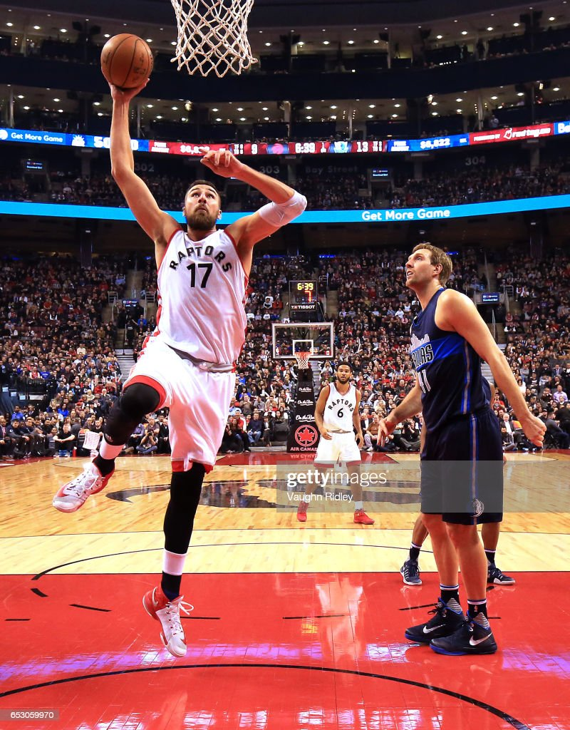Jonas Valanciunas #17 of the Toronto Raptors shoots the ball as Dirk Nowitzki #41 of the Dallas Mavericks looks on during the first half of an NBA game at Air Canada Centre on March 13, 2017 in Toronto, Canada.