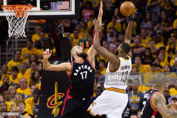 Jonas Valanciunas of the Toronto Raptors tries to block Tristan Thompson of the Cleveland Cavaliers during the first half of Game One of the NBA...