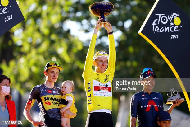 Jonas Vingegaard of Denmark and Team Jumbo-Visma and his daughter Frida, Tadej Pogačar of Slovenia and UAE-Team Emirates Yellow Leader Jersey &...