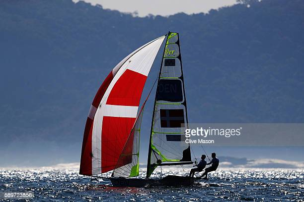 Jonas Warrer of Denmark and Christian Peter Lubeck of Denmark compete in the Men's 49ers class on Day 10 of the Rio 2016 Olympic Games at the Marina...