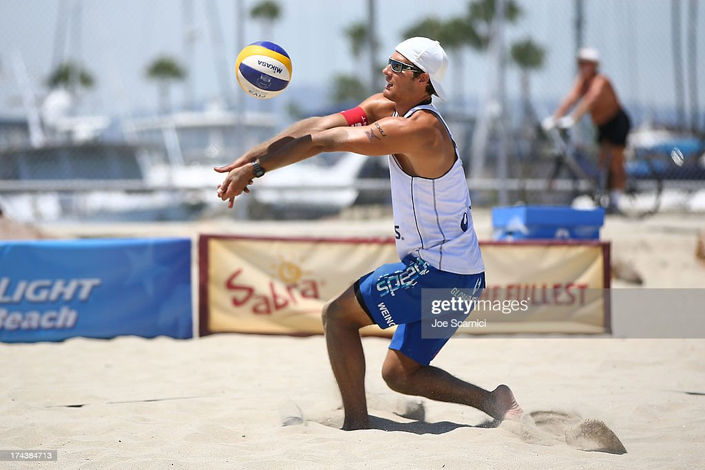 Jonas Weingart of Switzerland sets the ball during the round of pool play at the ASICS World Series of Beach Volleyball - Day 3 on July 24, 2013 in Long Beach, California.