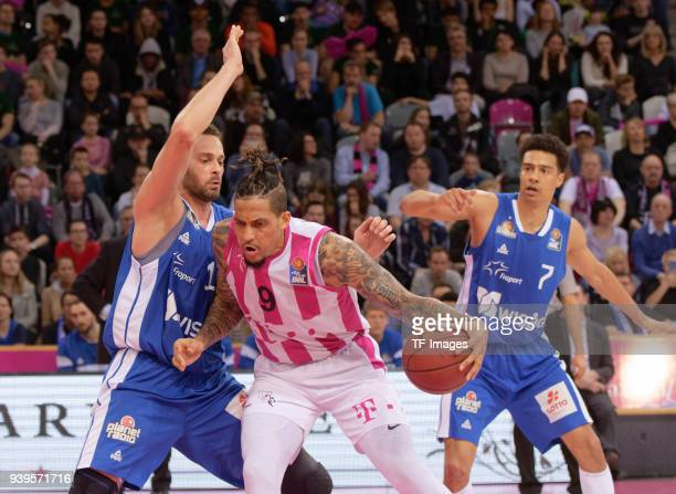 Jonas WohlfarthBottermann of Fraport Skyliners and Julian Gamble of Bonn battle for the ball during the Basketball Bundesliga match between Telekom...