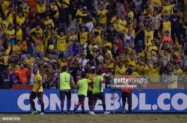 Jonatan Alves of Barcelona SC celebrates with teammates and fans after scoring the first goal of his team during a first leg match between Barcelona...