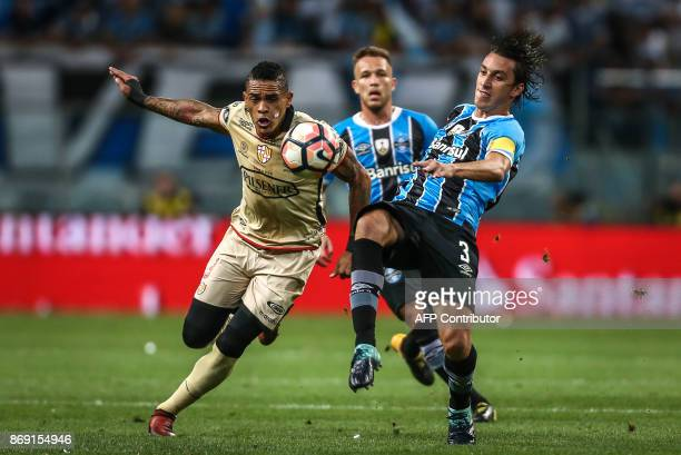 Jonatan Alves of Ecuador's Barcelona vies for the ball with Geromel of Brazil's Gremio during their Copa Libertadores 2017 football match held at the...