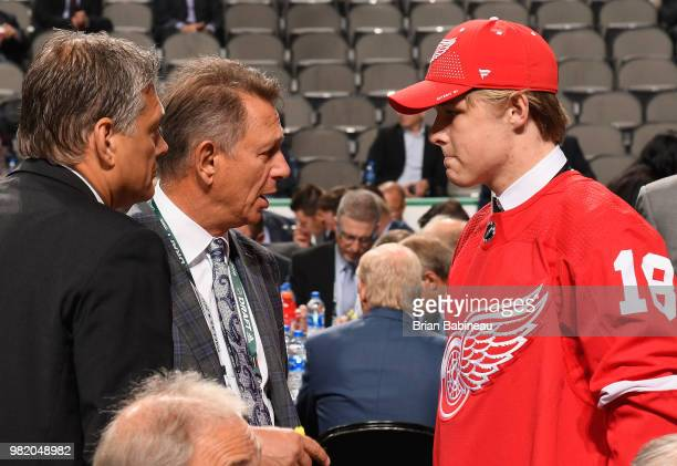 Jonatan Berggren speaks with general manager Ken Holland after being selected 33rd overall by the Detroit Red Wings during the 2018 NHL Draft at...