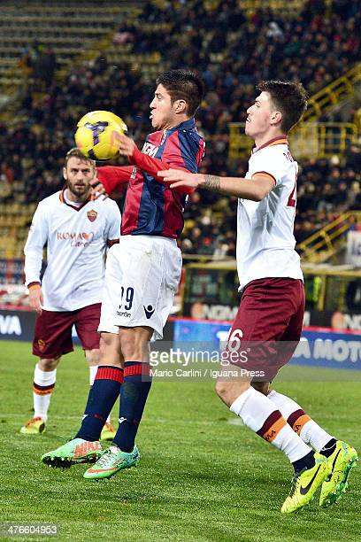 Jonatan Cristaldo of Bologna FC competes the ball with Alessio Romagnoli of AS Roma during the Serie A match between Bologna FC and AS Roma at Stadio...
