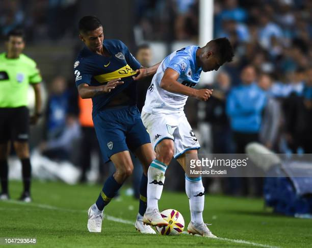 Jonathan Cristaldo of Racing Club fights for the ball with Agustin Almendra of Boca Juniors during a match between Racing Club and Boca Juniors as...