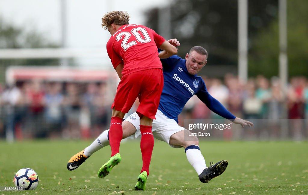 Jonatan Frimann of Twente is challenged by Wayne Rooney of Everton during a preseason friendly match between FC Twente and Everton FC at Sportpark de Stockakker on July 19, 2017 in De Lutte, Netherlands.