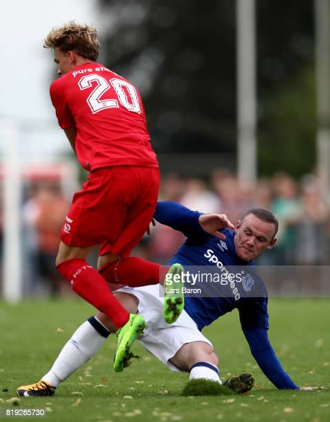Jonatan Frimann of Twente is challenged by Wayne Rooney of Everton during a preseason friendly match between FC Twente and Everton FC at Sportpark de...