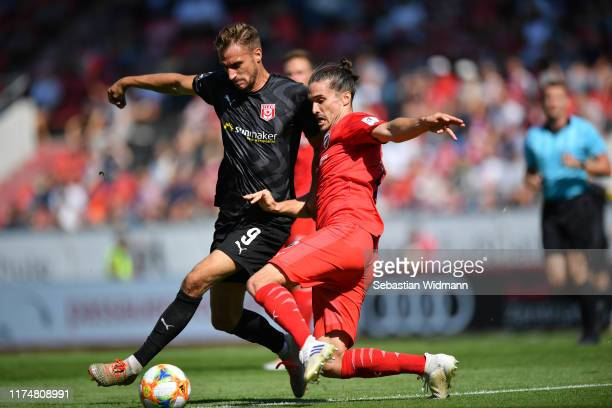 Jonatan Kotzke of Ingolstadt challenges Pascal Sohm of Hallescher FC for the ball during the 3. Liga match between FC Ingolstadt and Hallescher FC at...