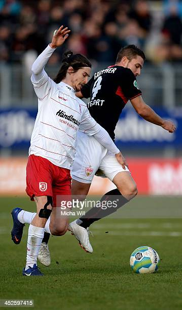 Jonatan Kotzke of Regensburg and Marco Gruettner of Stuttgart tussle for the ball during the Third League match between Jahn Regensburg and VfB...
