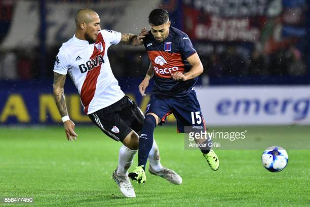 Jonatan Maidana of River Plate and Lucas Janson of Tigre fight for the ball during a match between Tigre and River Plate as part of Superliga 2017/18...
