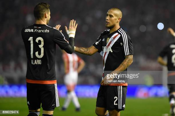 Jonatan Maidana of River Plate celebrates with teammate Lucas Alario after scoring the third goal of his team during a match between River Plate and...