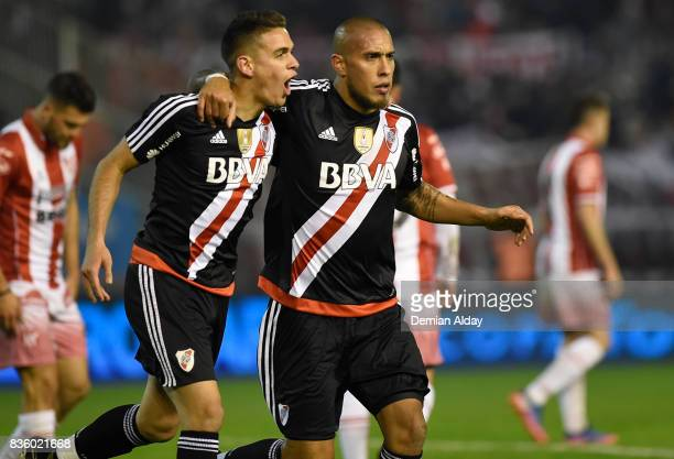 Jonatan Maidana of River Plate celebrates with teammate Rafael Santos Borre after scoring the third goal of his team during a match between River...