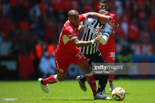 Jonatan Maidana of Toluca struggles for the ball with Rogelio Funes Mori of Monterrey during the 13th round match between Toluca and Monterrey as...