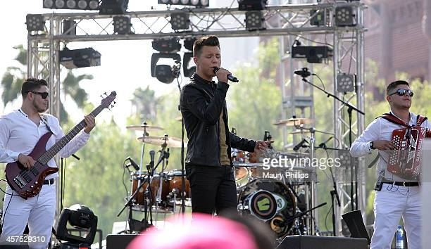 Jonatan Sanchez performs at Latin GRAMMY Street Parties In LA with Los Tucanes De Tijuana on October 19 2014 in Los Angeles California