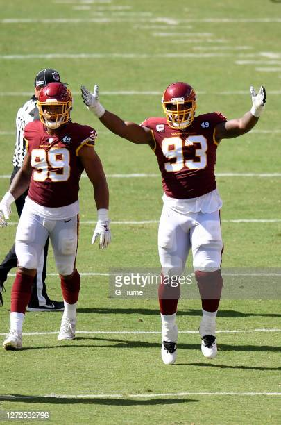Jonathan Allen and Chase Young of the Washington Football Team celebrate a defensive play against the Philadelphia Eagles in the second half at...