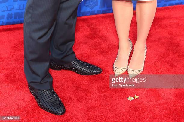 Jonathan Allen from Alabama and Fiance Hannah Franklin spiked shoes on the Red Carpet outside of the NFL Draft Theater on April 27 2017 in...