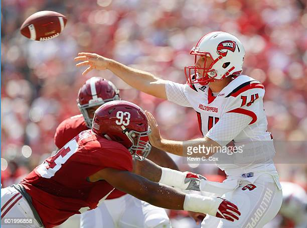 Jonathan Allen of the Alabama Crimson Tide pressures Mike White of the Western Kentucky Hilltoppers at BryantDenny Stadium on September 10 2016 in...