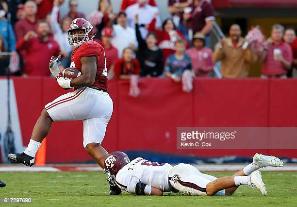 Jonathan Allen of the Alabama Crimson Tide returns a fumble for a touchdown as he steps over Trevor Knight of the Texas AM Aggies at BryantDenny...