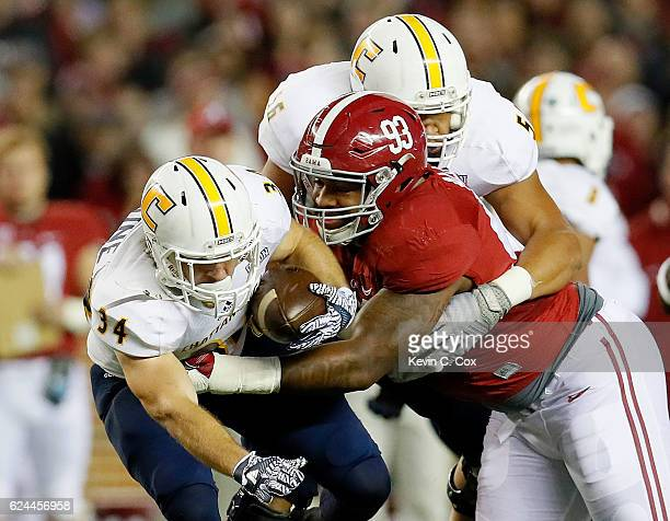 Jonathan Allen of the Alabama Crimson Tide tackles Derrick Craine of the Chattanooga Mocs at Bryant-Denny Stadium on November 19, 2016 in Tuscaloosa,...