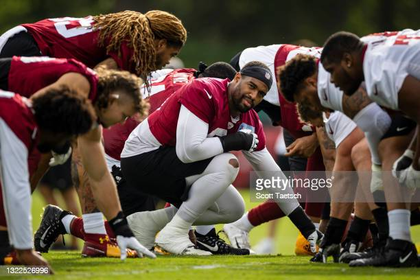 Jonathan Allen of the Washington Football Team participates in a drill during minicamp at Inova Sports Performance Center on June 8, 2021 in Ashburn,...