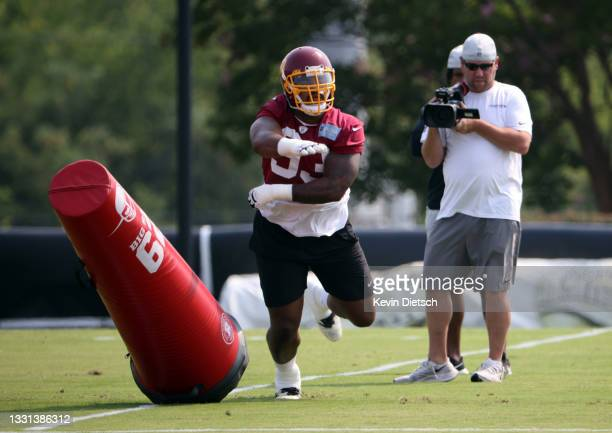 Jonathan Allen of the Washington Football Team takes part in a drill during training camp at the Bon Secours Washington Football Team training center...
