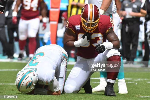 Jonathan Allen of the Washington Redskins celebrates after sacking Josh Rosen of the Miami Dolphins during the first quarter of the game at Hard Rock...