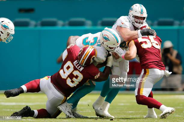 Jonathan Allen of the Washington Redskins sacks Josh Rosen of the Miami Dolphins during the first quarter at Hard Rock Stadium on October 13, 2019 in...