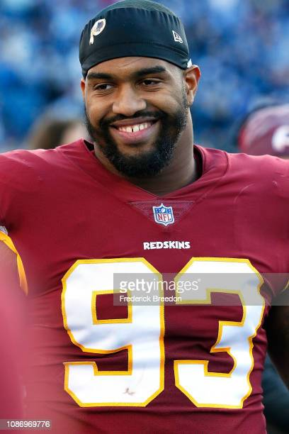 Jonathan Allen of the Washington Redskins watches from the sideline during a game against the Tennessee Titans at Nissan Stadium on December 22, 2018...