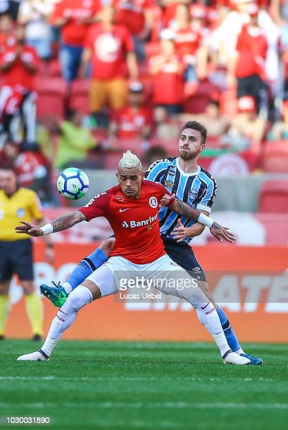 Jonathan Alvez of Internacional battles for the ball against Bressan of Gremio during the match between Internacional and Gremio as part of...