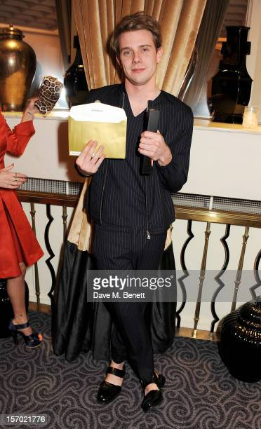 Jonathan Anderson of JW Anderson, winner of the Emerging Talent award, Ready-To-Wear, poses with award at the British Fashion Awards 2012 at The...