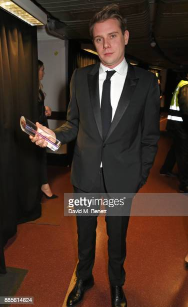 Jonathan Anderson winner of the Accessories Designer of the Year for Loewe poses backstage at The Fashion Awards 2017 in partnership with Swarovski...