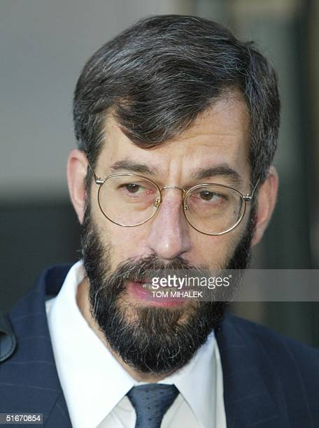 Jonathan Arden the Chief Medical Examiner for The District of Columbia answers a reporter's questions following his testimony 14 October 2002 at the...