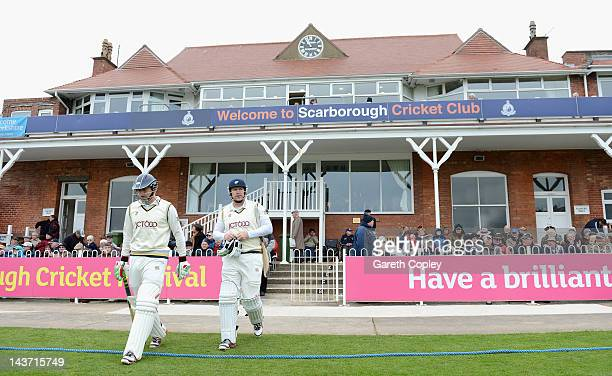 Jonathan Bairstow and Anthony McGrath walks on the field ahead of day two of the LV County Championship division two match between Yorkshire and...