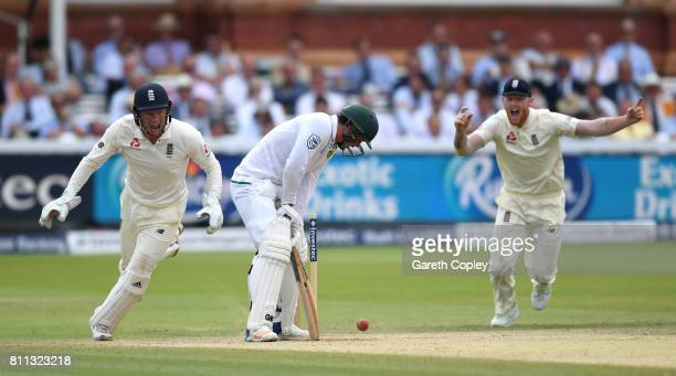 Jonathan Bairstow and Ben Stokes of England celebrate after Quinton de Kock of South Africa is bowled by Moeen Ali during the 4th day of the 1st...