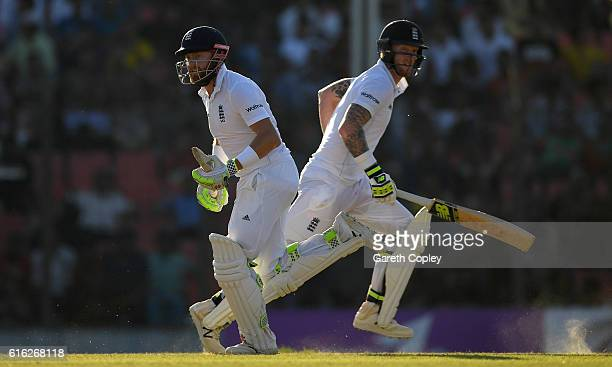 Jonathan Bairstow and Ben Stokes of England run between the wickets during the 3rd day of the 1st Test match between Bangladesh and England at Zohur...