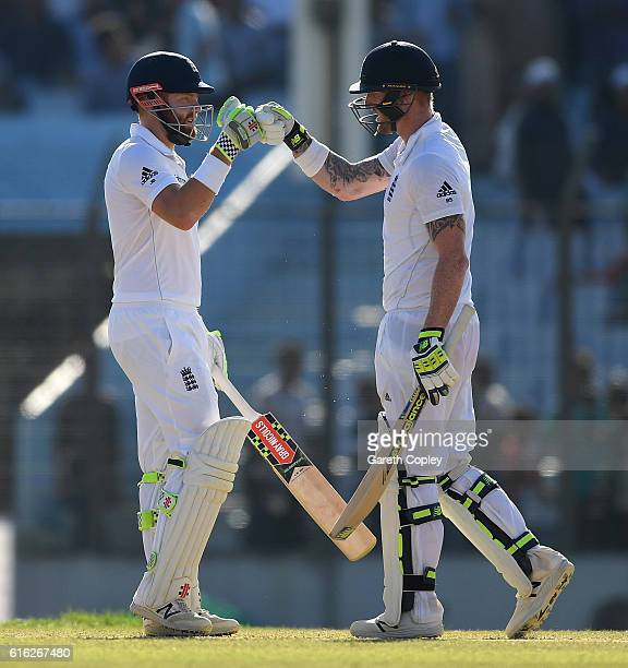 Jonathan Bairstow and Ben Stokes of England touch gloves during the 3rd day of the 1st Test match between Bangladesh and England at Zohur Ahmed...
