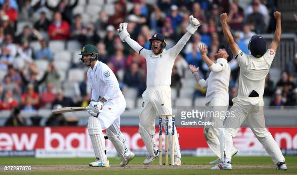 Jonathan Bairstow, Ben Stokes and Alastair Cook of England celebrates the final wicket of Duanne Olivier of South Africa to win the 4th Investec Test...
