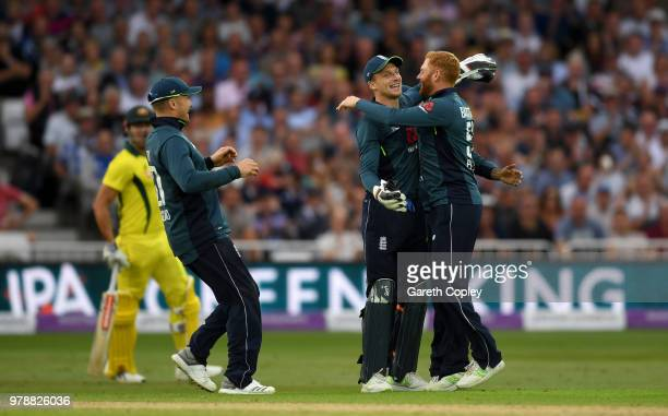 Jonathan Bairstow of England celebrates with Jason Roy and Jos Buttler after running out Marcus Stoinis of Australia during the 3rd Royal London ODI...