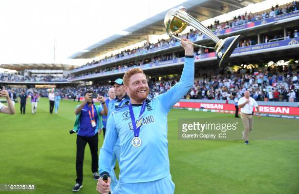 Jonathan Bairstow of England celebrates with the trophy after winning the Final of the ICC Cricket World Cup 2019 between New Zealand and England at...