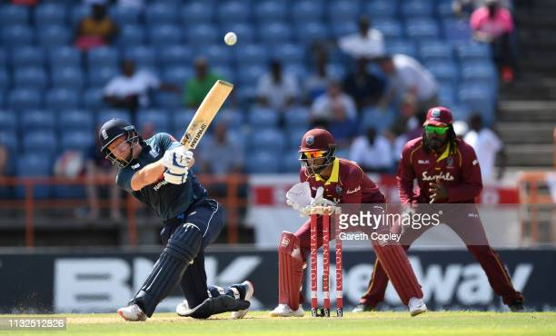 Jonathan Bairstow of England hits out for six runs during the 4th One Day International match between the West Indies and England at Grenada National...